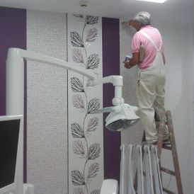 Painter painting the room